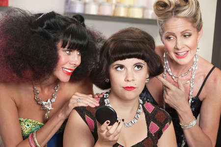 Annoyed pretty woman with older ladies in beauty salon Stock Photo - 16578072