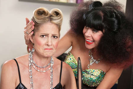 Angry white female with problem hairdo and comforting friend Stock Photo - 16578081