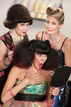 afro hairdo: Sympathetic friends and upset woman in beauty salon