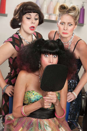 Shocked woman behind mirror with curious ladies in hair salon Stock Photo - 16680544