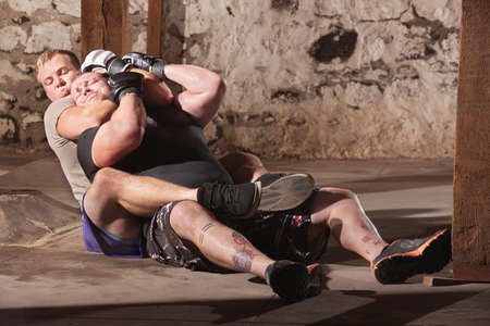 submission: Two men training in rear choke holds