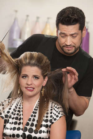 hair problem: Attractive female with hair problem and embarrassed hair stylist