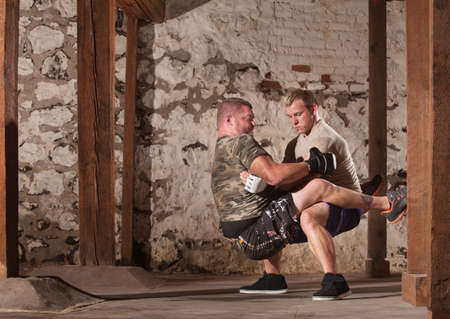 Mixed martial artists practicing guard sit ups photo