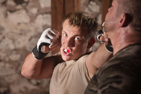 jab: Aggressive fighter throwing jab punches at opponent Stock Photo