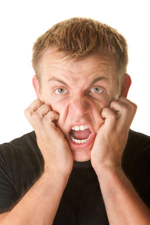 frantic: Angry man pulling skin on face over white background