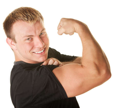 Blond Caucasian man over white background flexing biceps muscle photo
