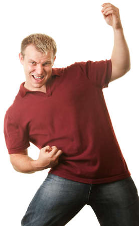 air guitar: Excited young athletic man playing air guitar Stock Photo