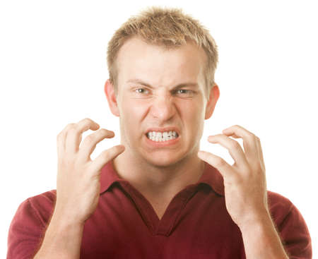 cranky: Angry blond muscular Caucasian man with clenched teeth Stock Photo