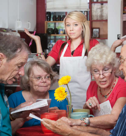 Frustrated waitress with customers trying to read the menu photo