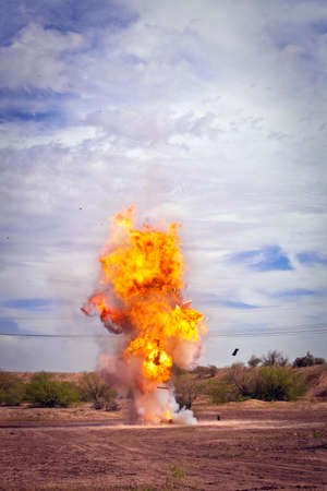 Controlled exploding fireball flames for movie outside photo