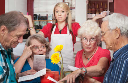Annoyed waitress and group of patrons arguing about the menu photo