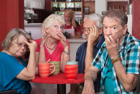 loud: Loud mouth woman embarrassing group of friends in cafe Stock Photo