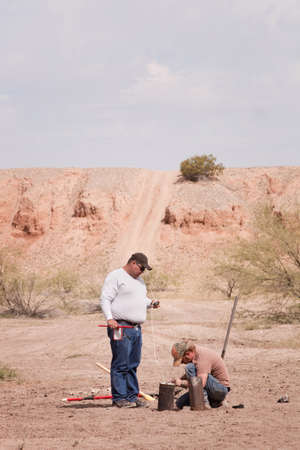 incendiary: Two men in special effects team setting up explosives