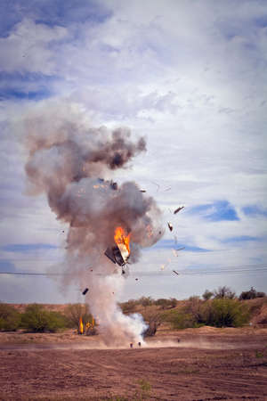 controlled: Movie EFX controlled explosion of appliance in a desert