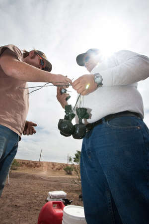 incendiary: Special effects crew members tying bags of explosive powder