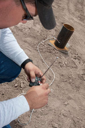 incendiary: Pyrotechnic expert setting up remote control device