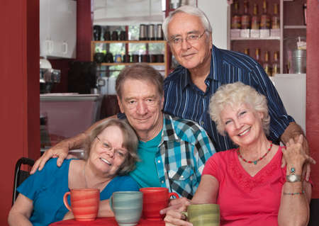 Group of Caucasian older people sitting together in a bistro photo