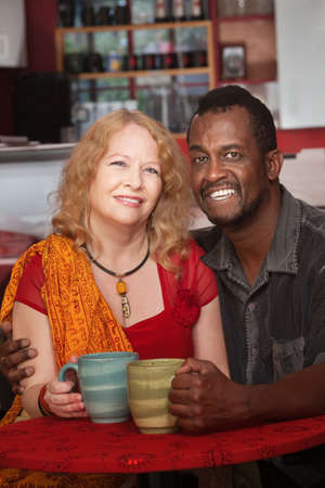 Happy mixed Black and white mature couple in cafe Stock Photo - 17019867