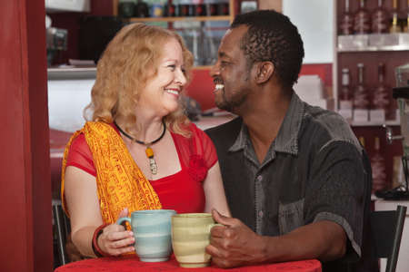 Smiling mixed Black and white couple in cafe photo