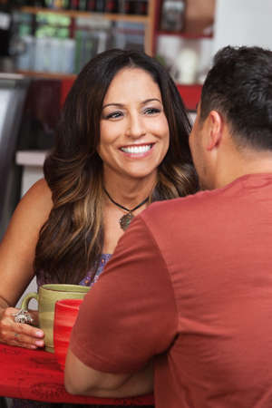 Pretty Mexican woman with male friend in cafe Stock Photo - 17019829