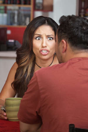 Furious woman yelling at man in restaurant Stock Photo - 17019638