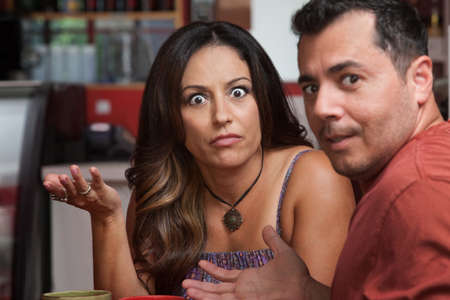 mature mexican: Annoyed Latino male and female looking over in cafe