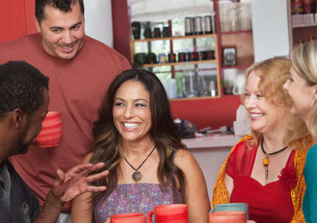 Pretty Hispanic woman and diverse group of friends Stock Photo - 17019641