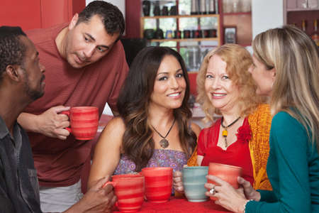 mature mexican: Attractive mature women in diverse group at coffeehouse Stock Photo