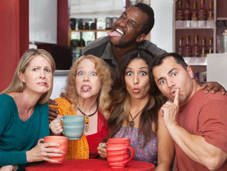 mature mexican: Mixed group of friends making faces in a cafe