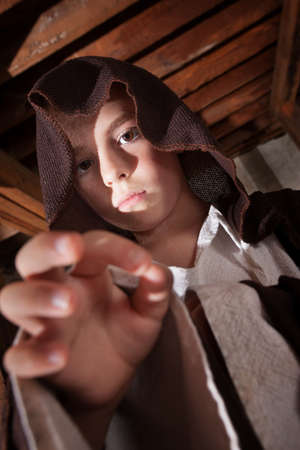 Young boy dressed as a science fiction character reaching out photo