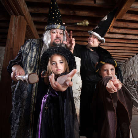Cute family of people dressed in Halloween costumes Stock Photo