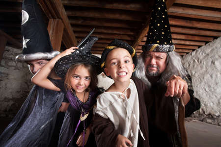 Happy family of sorcerers together indoors Foto de archivo