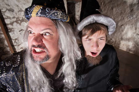 Evil long haired wizard with teenage son photo