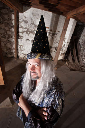 Clever man dressed as a wizard with long hair