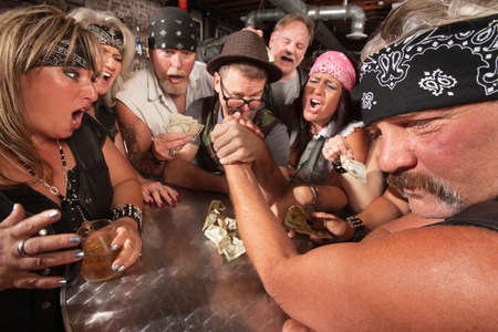Motorcycle gang members arm wrestling with a nerd