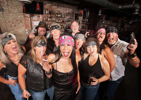 Loud motorcycle gang members with weapons and drinks Stock Photo - 17290385