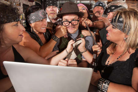 Annoyed motorcycle gang sticks up nerd using laptop photo