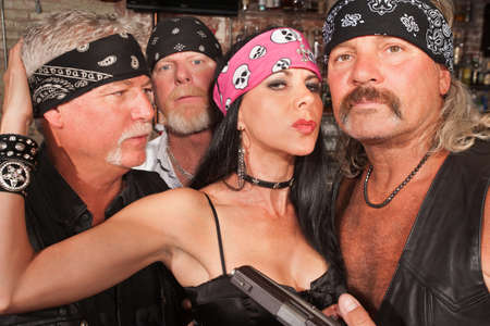 Sexy mature white female with three biker gang boyfriends photo