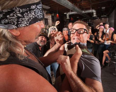 Nerd threatening tough gang member grabbing him by the collar photo