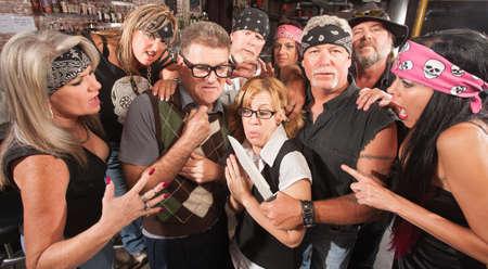 Motorcycle gang robbing Caucasian nerd couple in bar Stock Photo - 17544371