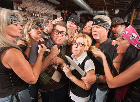 Group of thugs teasing nerds in a bar Stock Photo - 17544374