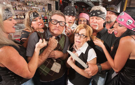 Biker gang mugging scared nerd couple in bar Stock Photo - 17591138