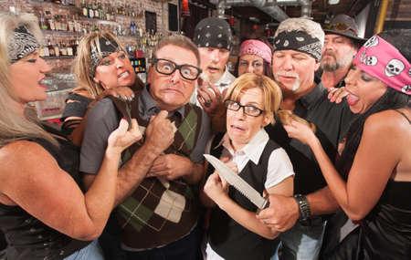 Biker gang mugging scared nerd couple in bar Stock Photo - 17591138
