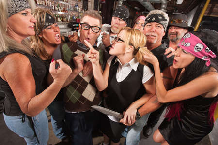 Female nerd with husband confronting biker gang thugs in bar Stock Photo - 17591107