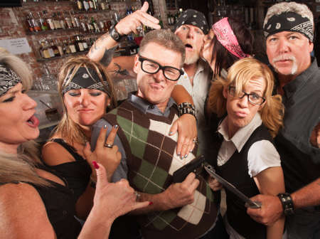 Nerd husband and wife being cool with biker gang in bar Stock Photo - 17591175