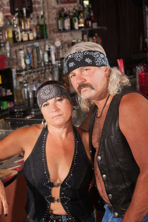 bandanna: Attractive middle aged biker couple with bandannas in bar