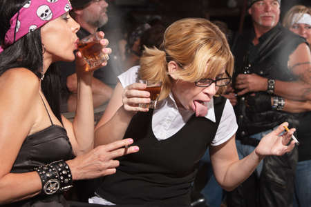 Nerd gagging on alcohol while drinking in bar Stock Photo - 17591145