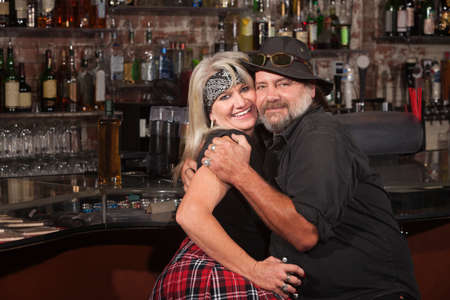 Happy middle aged couple embracing in a tavern Stock Photo - 17591123
