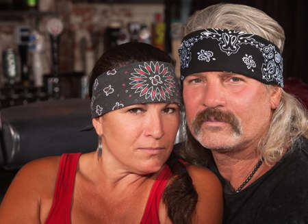 Serious middle aged couple in bandannas at a bar Stock Photo - 17591155