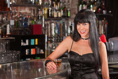 Sexy European woman in black dress smiling at a bar Stock Photo - 17591146